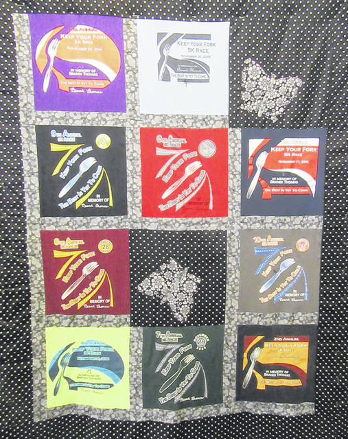 Also on display was a quilt made from several of the past race shirts.