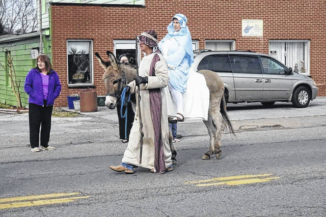 Bend Area Christmas Parades will feature a number of Biblical floats that will take viewers from the angel visiting Mary, all the way to the empty tomb following the resurrection. Pictured are Mary and Joseph traveling to Jerusalem in last year's parades.