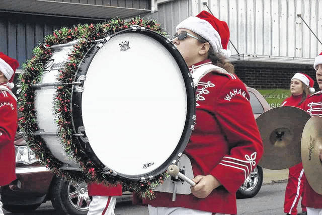 A member of the Wahama White Falcons Marching Band gets in the holiday spirit during one of last year's Christmas parades.