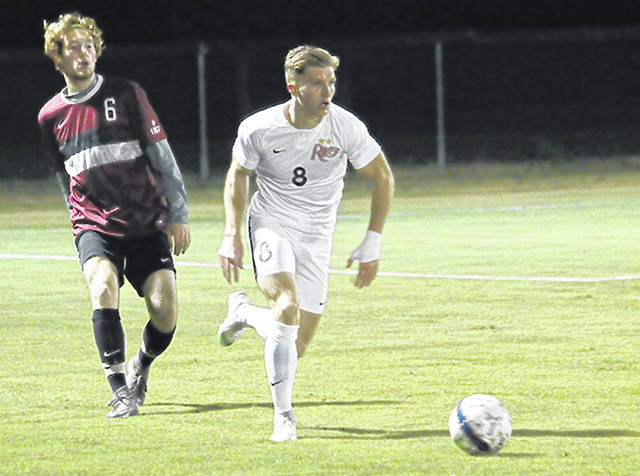 Rio Grande's Harry Reilly speeds past Indiana East's Nate Guenther during the first half of Wednesday night's River States Conference Men's Soccer Championship semifinal game at Evan E. Davis Field. Reilly scored both goals in the top-seeded RedStorm's 2-0 win over the Red Wolves.
