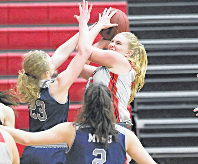 Rio Grande's Megan Liedtke attempts to put up a shot during the second half of Saturday's game against Mount Vernon Nazarene at the Newt Oliver Arena. The RedStorm posted an 83-60 win over the Cougars.