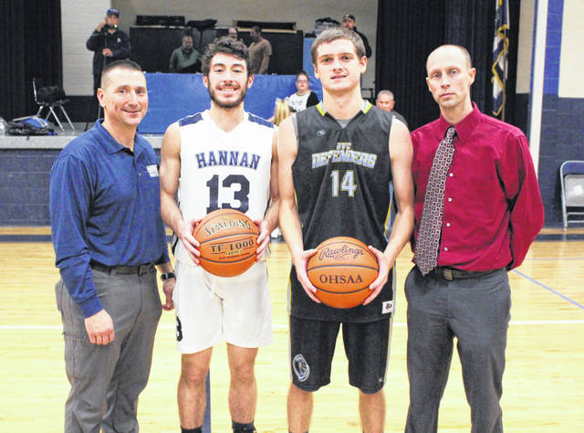 Hannan senior Dalton Coleman (13) and Ohio Valley Christian senior Justin Beaver (14) both reached the 1,000-point career plateau on Friday night during the Wildcats' 65-47 victory over the Defenders in a non-conference matchup in Ashton, W.Va. Joining the record-setting duo are HHS coach Shawn Coleman, left, and OVCS coach Steve Rice.