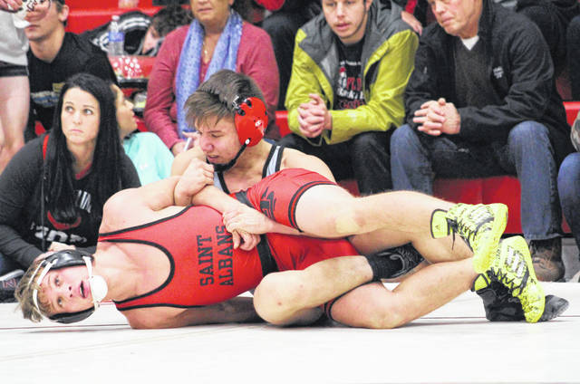 Point Pleasant senior George Smith locks in a hold on a Saint Albans grappler during a 138-pound match Saturday at the 2018 Jason Eades Memorial Duals held at Point Pleasant High School in Point Pleasant, W.Va.