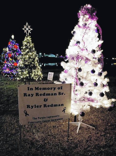 Many of the trees placed in the park at Mason for the inaugural year are in honor or memory of loved ones. Pictured is a tree erected in memory of Ray Redman, Sr. and Ryler Redman.
