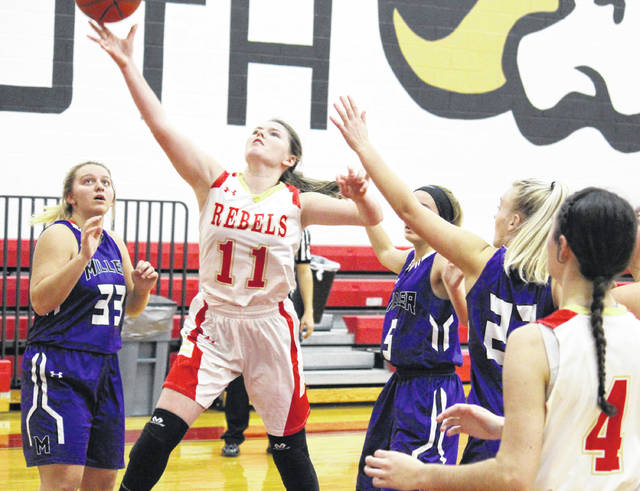 South Gallia freshman Jessie Rutt (11) tries a two-pointer, during the Lady Rebels' 55-41 setback on Thursday in Mercerville, Ohio.