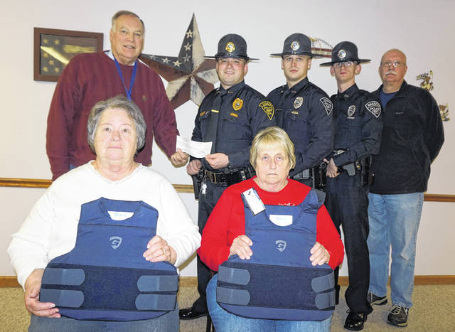 A grant from the Robert and Louise Claflin Foundation has enabled the Mason Police Department to purchase three bulletproof vests. Pictured in front, with two of the vests, are council members Sharon Kearns, left, and Becky Pearson. Shown in the back, from left, are Stephen Littlepage, president of the Claflin Foundation; Police Chief Colton McKinney; Officer Tyler Doss; Officer Clayton Gibbs; and Marty Yeager, council member and police commissioner.