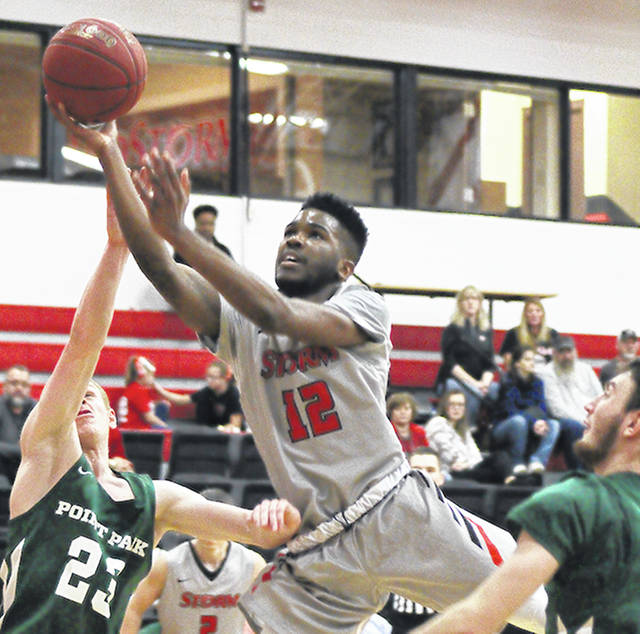 Rio Grande's Kyle Lamotte drives to the basket during the first half of Saturday's game against Point Park University at the Newt Oliver Arena. Lamotte scored eight points in his season debut as the RedStorm defeated the Pioneers, 78-73.