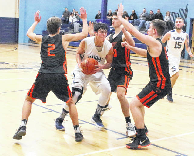 Hannan junior Chandler Starkey is surrounded by a trio of Wirt County defenders during the second half of Monday night's boys basketball contest in Ashton, W.Va.