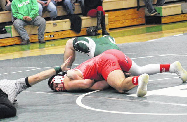 Wahama senior Antonio Serevicz scores a pinfall victory over an Eagle, during the 'Battle of the Birds' on Wednesday in Tuppers Plains, Ohio.