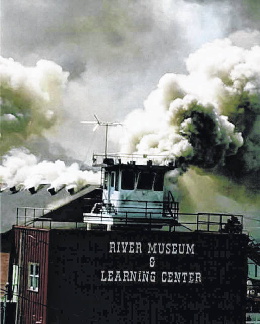 This photo taken by Teri Deweese shows the smoke rolling out of the roof of the Point Pleasant River Museum on the day of the fire. Deweese donated the photo to the museum.