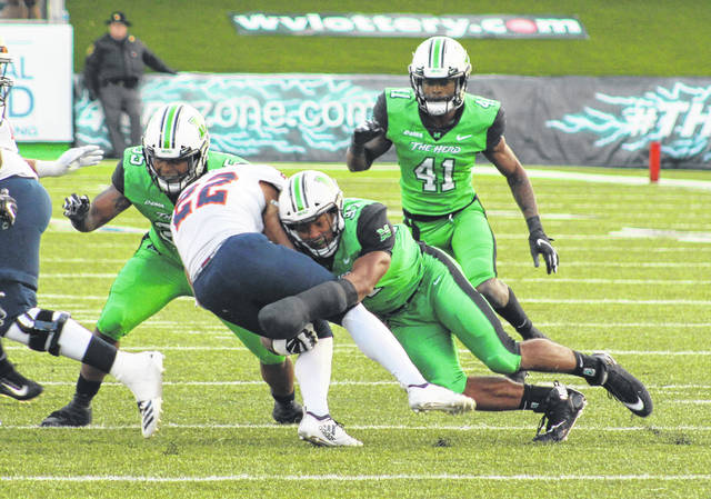 Marshall linebacker Chase Hancock (37) takes down a UTSA ball carrier during a Nov. 17 football contest at Joan C. Edwards Stadium in Huntington, W.Va.