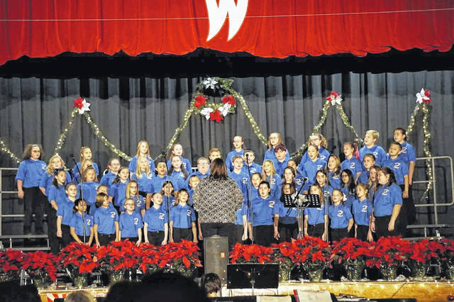 "The annual Bend Area C.A.R.E. Christmas Concert, featuring entertainment from students at both Wahama High School and New Haven Elementary School, will be held Sunday, 2 p.m., at the Wahama gymnasium. Proceeds from admission go to the C.A.R.E. organization's ""Kids for Christmas"" program. Pictured is the New Haven Elementary School Choir, under the direction of Kimberly Bond, during last year's concert."
