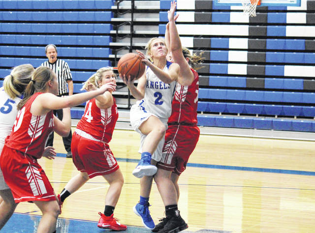 Gallia Academy senior Abby Cremeans (2) attempts a layup, during the Blue Angels' 63-37 victory on Monday in Centenary, Ohio.