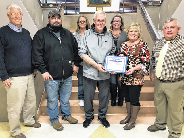 Pictured from left, Commissioner Rick Handley, AJ Powell, Tammy Trippett, Milt Trippett, Nikki Powell, Commissioners Tracy Doolittle and Sam Nibert.