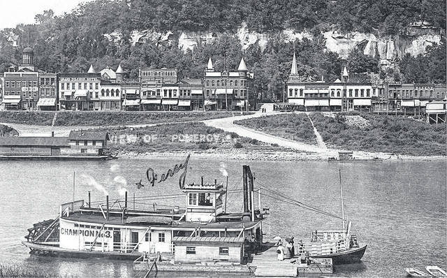 CHAMPION No. 3 docked at the wharf at Mason, West Virginia, with Pomeroy in the background, taken in 1910. A streetcar, as well as the Pomeroy passenger depot visible in the background.