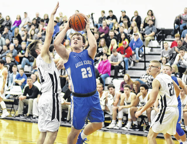 GAHS junior Ben Cox (23) attempts a shot during the first half of the Blue Devils 91-39 victory over River Valley on Tuesday night in Bidwell, Ohio.