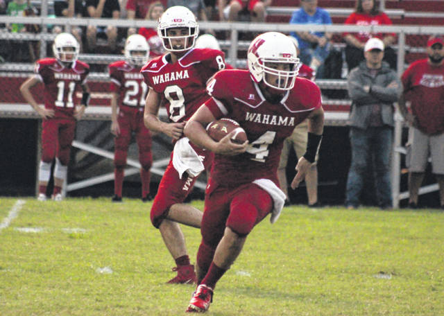 Wahama's Brady Bumgarner (4) takes a handoff from Abram Pauley (8), during the White Falcons' loss to Southern on Sept. 7 in Mason, W.Va.