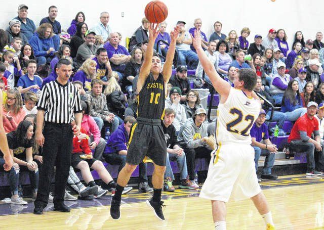 Eastern senior Sharp Facemyer (10) launches a three-pointer over Southern junior Coltin Parker (22), during the Eagles' 11-point win on Friday in Racine, Ohio.