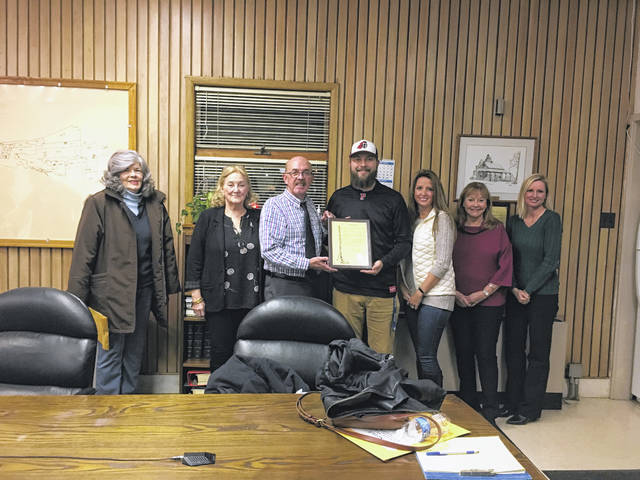 Pictured is Mayor Brian Billings presenting Councilman Gabe Roush, who is an athletic trainer for Point Pleasant High School, with a proclamation commending the coaches, staff, football players, and trainers for this year's 9-2 varsity football season. Also pictured, from left to right, are Councilwomen Elaine Hunt and Jerrie Howard, City Clerk Amber Tatterson, Councilwomen Janet Hartley and Leigh-Ann Shepard.