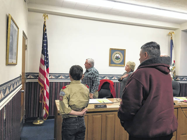 Dalton Dexter from Boy Scout Troop 258 leading those at the Mason County Commission in the Pledge of Allegiance.
