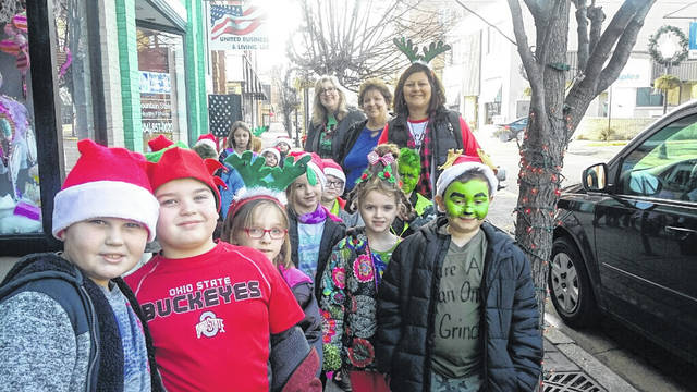 The students went around Point Pleasant spreading Christmas cheer by singing Christmas carols.