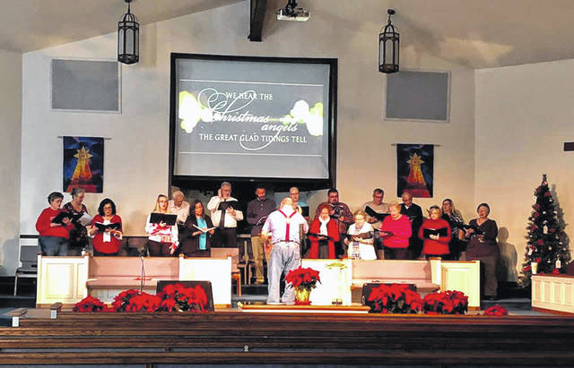 Those involved with this year's Christmas Cantata preparing for their upcoming performance.