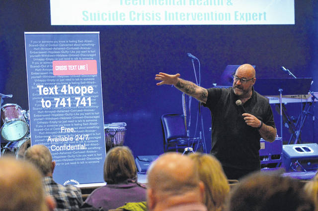 Suicide and crisis intervention professional Jeff Yalden addresses audience members at River City Fellowship Church.