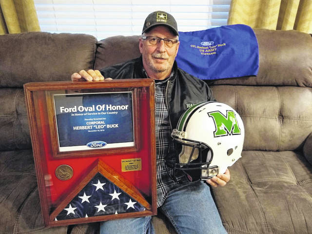 Leo Buck pictured with items he received at a Marshall University game for being a Ford Oval of Honor (FOH) recipient.