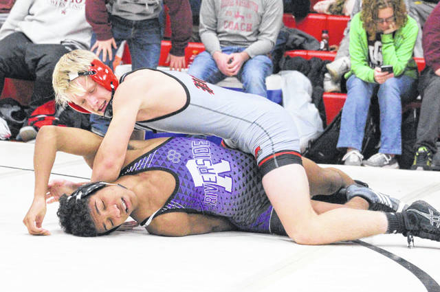 Point Pleasant sophomore Wyatt Wilson locks in a hold on a Riverside opponent during a 152-pound match at the Jason Eades Memorial Duals tournament on Dec. 8 at Point Pleasant, W.Va.