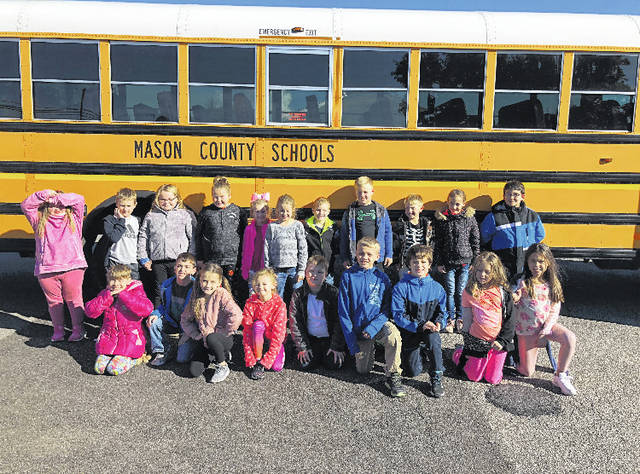 Pictured is Mrs. Hunt's class in front of a Mason County school bus.