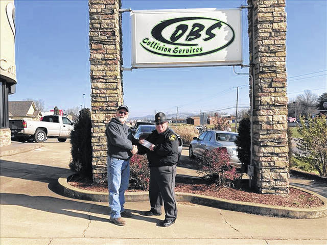 OBS Collision owner Glenn Lawson stands with Mason County Sheriff Greg Powers. OBS Collision recently donated $500 to the department in support and appreciation of law enforcement.
