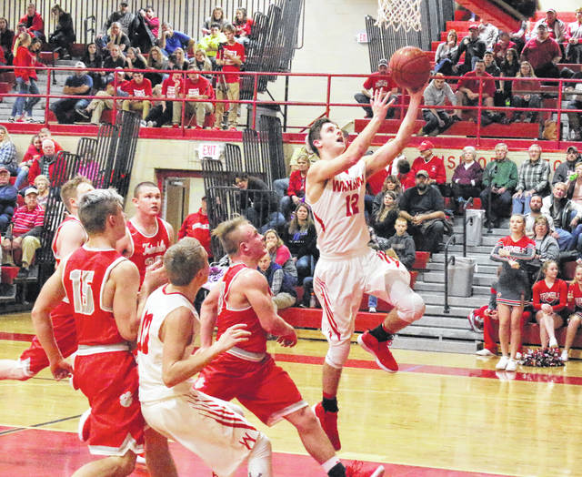 Wahama senior Abrahm Pauley (12) releases a shot attempt during the first half of Friday night's TVC Hocking boys basketball contest against Trimble at Gary Clark Court in Mason, W.Va.