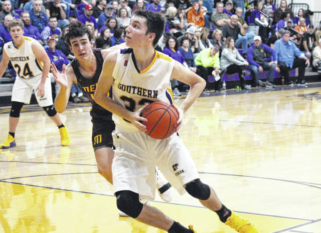 Southern senior Brayden Cunningham looks toward the basket, during the Tornadoes non-conference battle against Meigs on Nov. 30, 2018, in Racine, Ohio.