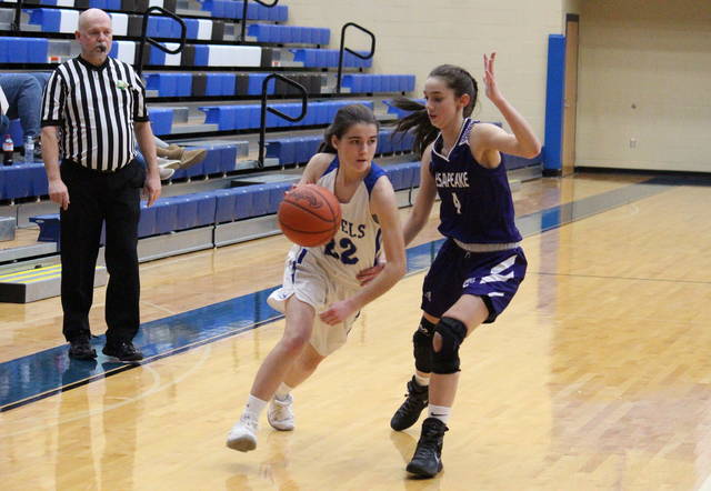 Gallia Academy's Chasity Adams (22) drives past Chesapeake's Blake Anderson (4), during the Lady Panthers' 44-29 victory on Thursday in Centenary, Ohio.
