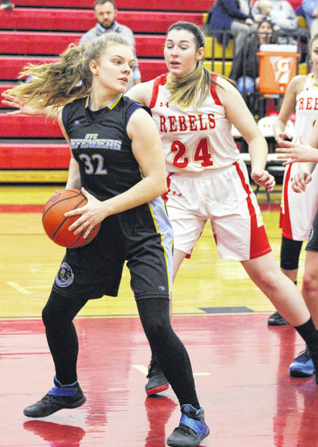 OVCS freshman Maison Gruber (32) hauls in a rebound during a Dec. 18, 2018, girls basketball contest against South Gallia in Mercerville, Ohio.
