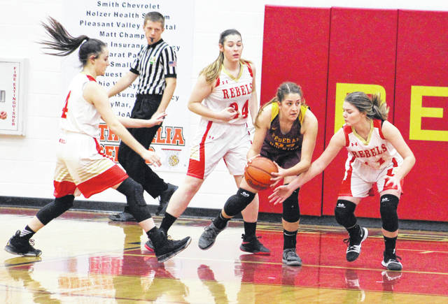 South Gallia defenders Kiley Stapleton (4), Christine Griffith (24) and Jessie Rutt (11) apply pressure to Federal Hocking's Hannah Rose during the first half of Monday night's TVC Hocking girls basketball contest in Mercerville, Ohio.