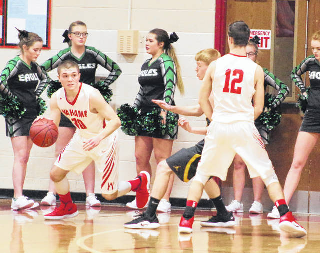 Wahama senior Jacob Lloyd uses a screen to get free during the first half of Tuesday night's boys basketball contest against Eastern at Gary Clark Court in Mason, W.Va.