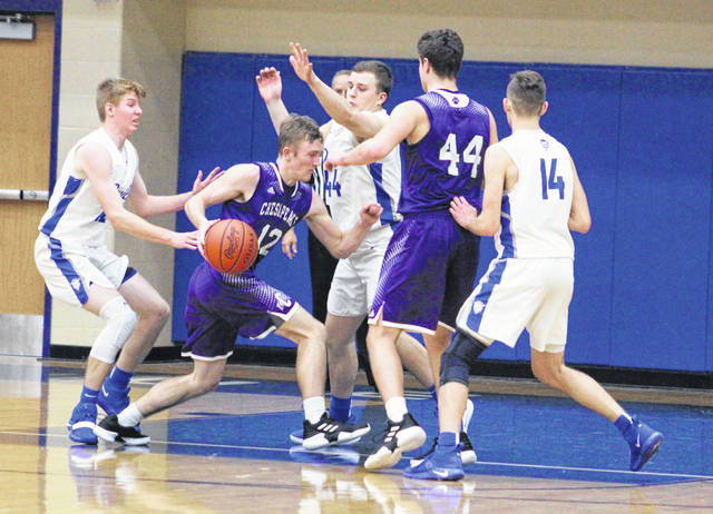 Gallia Academy senior Bailey Walker (44) prevents a Chesapeake player from driving into the lane during the second half of Friday night's OVC boys basketball contest in Centenary, Ohio.