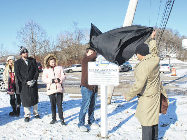 """Shannon Scott and James Stanley unveil the first Bicentennial Marker which recognized what was called the """"Kerrs Run Colored School."""""""