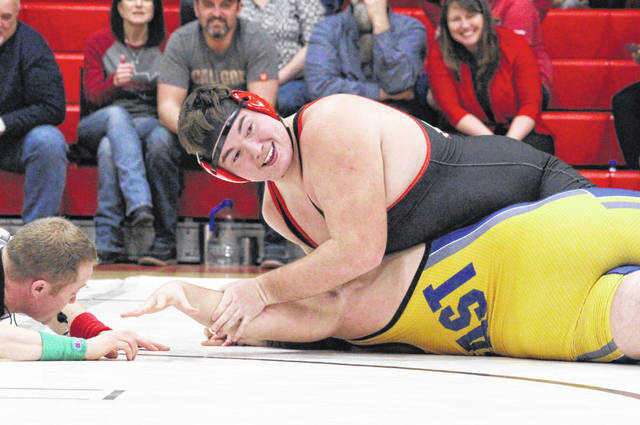 Point Pleasant junior Jacob Muncy maintains leverage on an East Fairmont opponent during a 285-pound match Wednesday at Point Pleasant High School in Point Pleasant, W.Va.