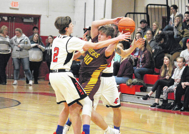 Meigs junior Austin Mahr (40) passes out of a trap from Big Blacks Kyelar Morrow (2) and Bradyn Canterbury, during the Marauders' 82-44 victory on Tuesday in Point Pleasant, W.Va.