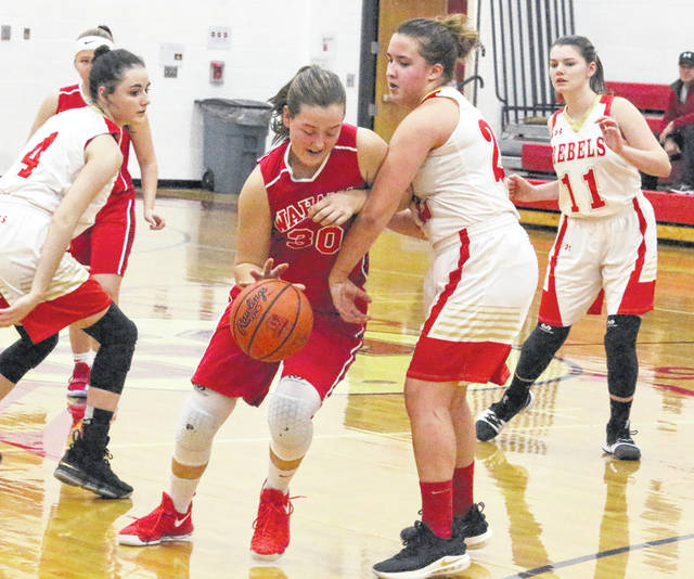 Wahama freshman Lauren Noble (30) dribbles past South Gallia defender Makayla Waugh during the second half of Thursday night's TVC Hocking girls basketball contest in Mercerville, Ohio.