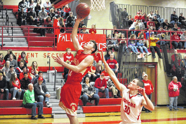 South Gallia junior Kyle Northup (left) makes a two-pointer in front of Wahama senior Jacob Lloyd (30), during the Rebels' 64-34 victory on Friday at Gary Clark Court in Mason, W.Va.