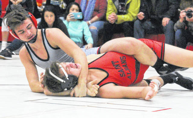 Point Pleasant sophomore Mitchell Freeman locks in a hold on a Saint Albans opponent during the 2018 Jason Eades Memorial Duals held on Dec. 8 in Point Pleasant, W.Va.