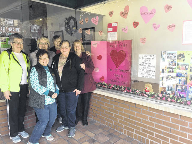Pictured are Avalanche CEOS Club members Yvonne Fetty, Patty Johnson, Sue Darst, Eleanor Hoffman, Anne Byus, and Susan Paulson after decorating the <em>Point Pleasant Register's</em> window.