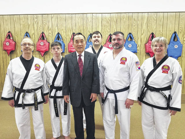 Those pictured, from left to right, are Master Ted Siders, son Bryce, Grandmaster S.H. Kang, James Lee, Frank Holcomb, and Master Pam Siders.