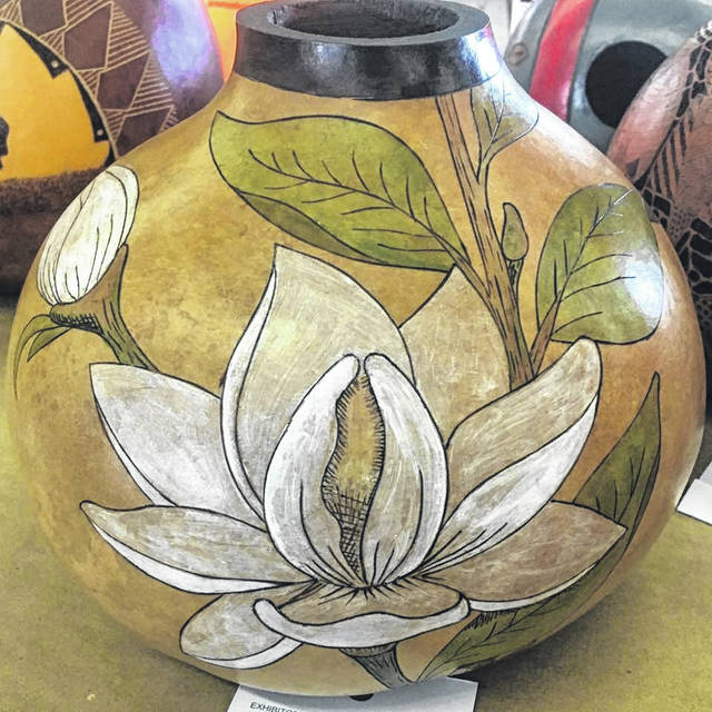 A piece of gourd artwork made by Nancy Vanco.