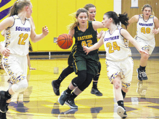 Eastern's Jaymie Basham (42) brings the ball across midcourt in front of Southern's Brooke Crisp (24), during the Lady Eagles' 58-16 victory on Thursday in Racine, Ohio.
