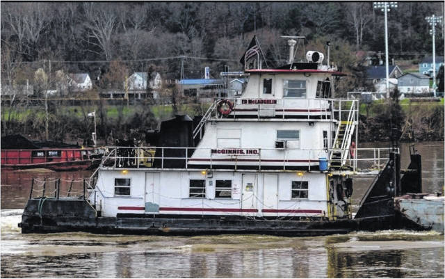 A photo of the Ed McLaughlin, owned by McGinnis Marine, capsized on the Ohio River at mile marker 259 on Friday near Cheshire.
