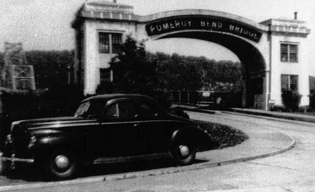 This photo, taken around 1940, from the collection of Bob Graham shows Pomeroy Bend Bridge Toll House in Mason, West Virginia. The toll house was closed after the bridge was paid for. The Pomeroy Bend Bridge has since been demolished and replaced with the Bridge of Honor which now connects Ohio and West Virginia at Pomeroy and Mason.